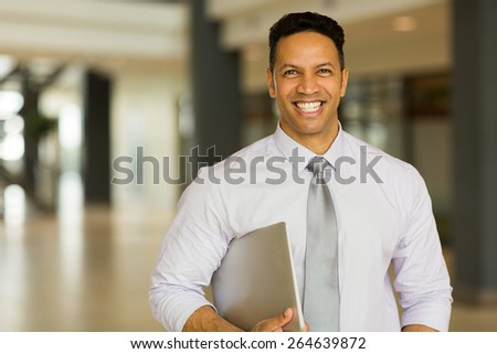 modern middle aged businessman with laptop computer in office - stock photo