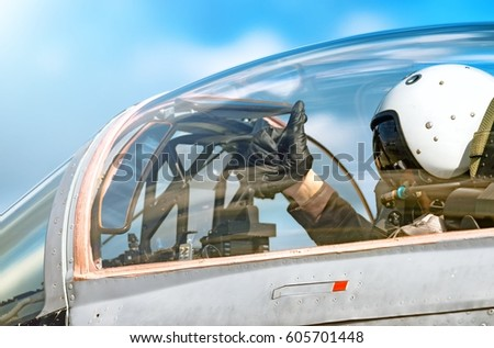Modern military fighter jet aircraft canopy exterior close up silhouette view pilot waving OK gesture inside & Modern Military Fighter Jet Aircraft Canopy Stock Photo 605701448 ...