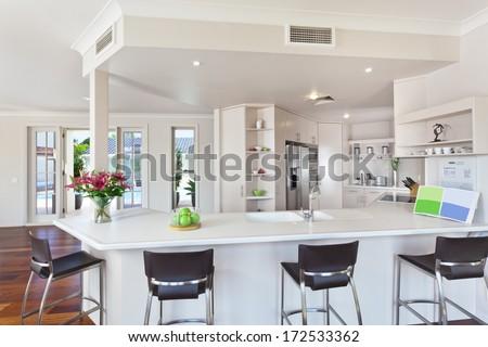 modern minimal white kitchen in australian home - stock photo