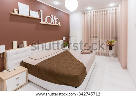 Modern minimalism style bedroom interior in light warm tones. - stock photo