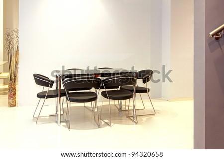 Modern minimalistic dinning table in modern interior - stock photo