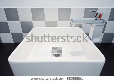 modern minimalistic hand wash basin in square shape - stock photo