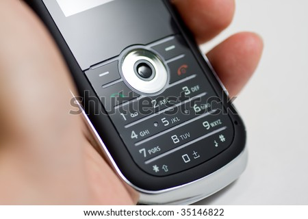 Modern mobile or cell phone for global communication services - stock photo