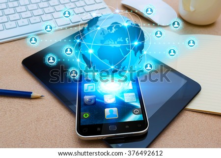 Modern mobile phone in office with social network application - stock photo