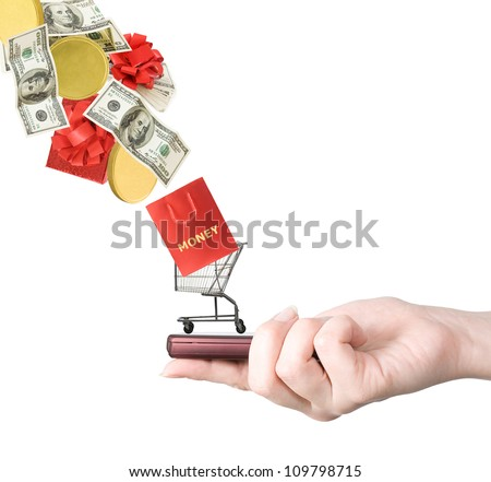 Modern mobile phone in the hand with shopping cart and money flying to isolated on white background (business concept)