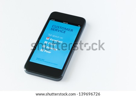 Modern mobile phone with customer service survey form on a screen. Red tick on excellent checkbox showing customer satisfaction. Isolated on white background. - stock photo