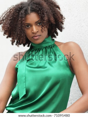 Modern model in green - stock photo
