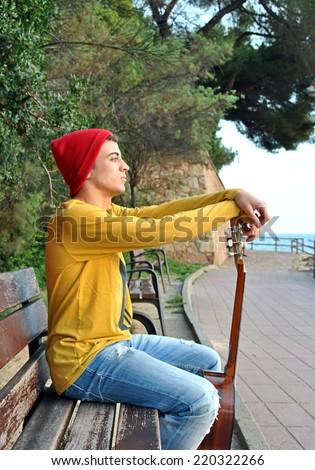modern musician posing with his Spanish guitar - stock photo