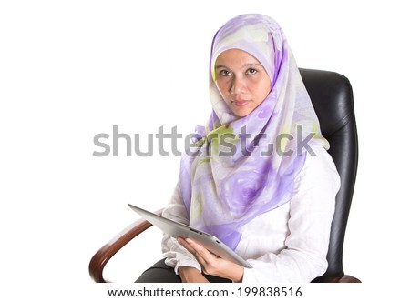 Modern Muslim businesswoman with hijab and computer tablet over white background