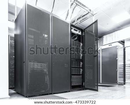 Modern network and telecommunication technology computer concept: server room in datacenter. Black  white