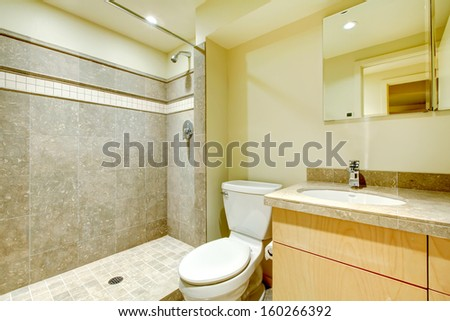 Modern new bathroom interior with grey tiles shower.