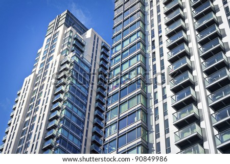 Modern, new executive apartments and with deep blue summer sky - stock photo