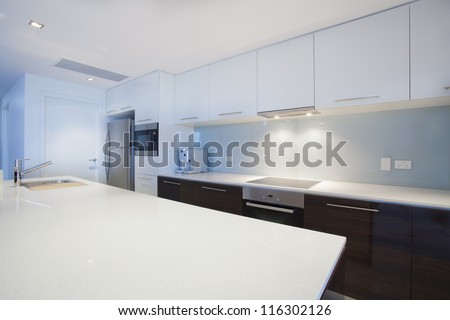 Modern new kitchen with stainless steel appliances - stock photo