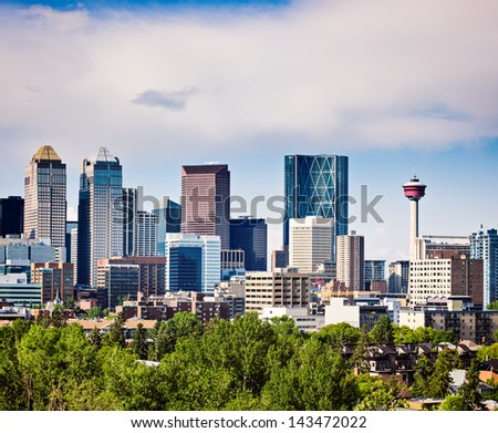 Modern North American Downtown.Alberta's Oil and Gas engine-Calgary.Picture taken while downtown is being flooded by a major storm in it's history.Copy space intentionally left above the city skyline. - stock photo