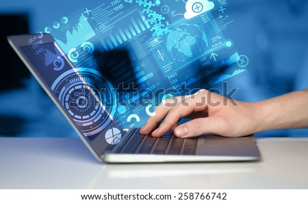 Modern notebook computer with future technology media symbols - stock photo