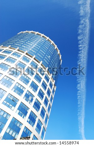 Modern office building against blue sky - stock photo