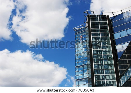 Modern office building against the cloudy sky - stock photo