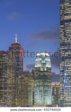 Modern office building and skyline of Hong Kong City at dusk - stock photo