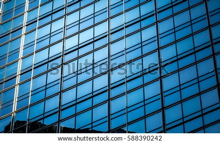 Modern office building detail, glass surface at Central, Hong Kong at FEB 2017