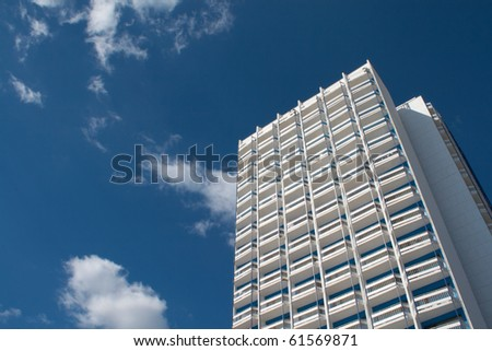 Modern office building growing into the sky - stock photo