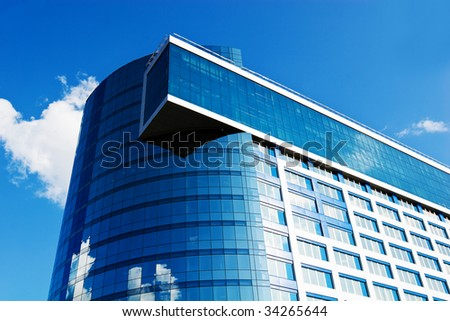 Modern office building on blue sky, daylight - stock photo