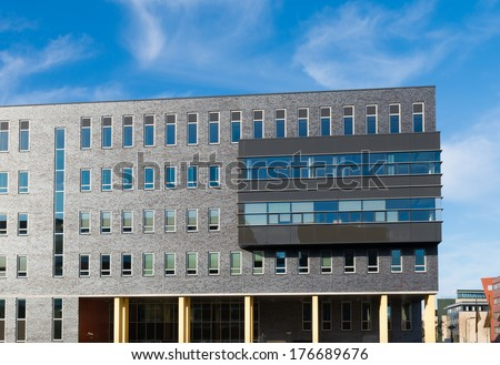 modern office building partly on pillars - stock photo