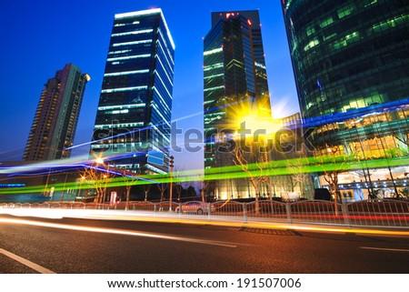 Modern office building rainbow ray background night in Shanghai - stock photo