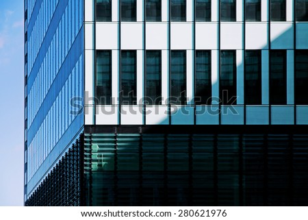 Modern office building tower in financial district - stock photo