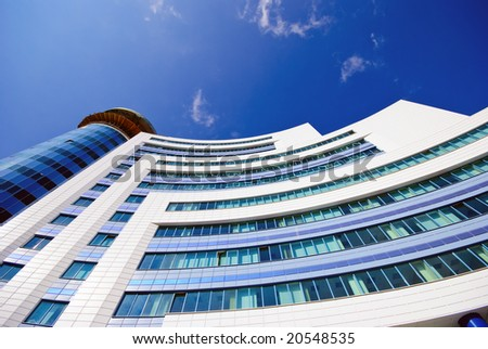 Modern office building. Wide lens used to take picture - stock photo