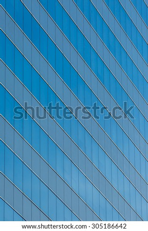 Modern office building with glass reflection background