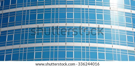Modern office building with glass surface - stock photo