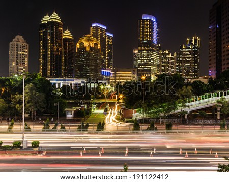 Modern office buildings captured at night in Jakarta central business district, Indonesia - stock photo