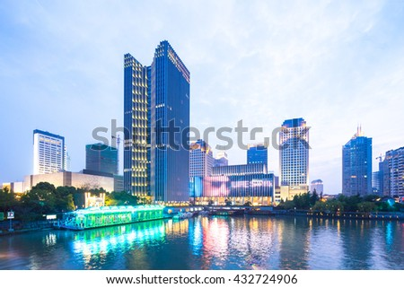 modern office buildings near water at twilight