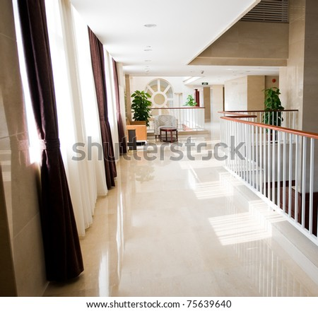 Modern office corridor in contemporary office building - stock photo