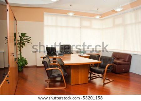 Modern office interior  - director's office with a place for meetings - stock photo