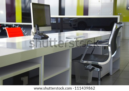 Modern office interior with red chairs and white furniture - stock photo