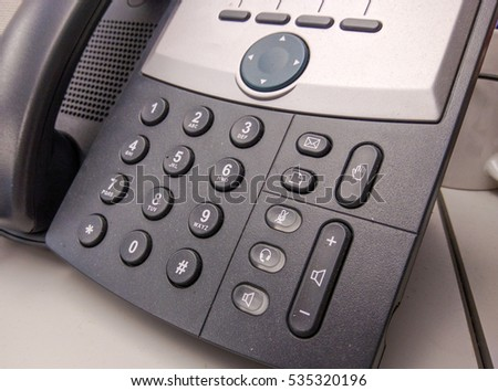 Modern office phone using VoIP technology.