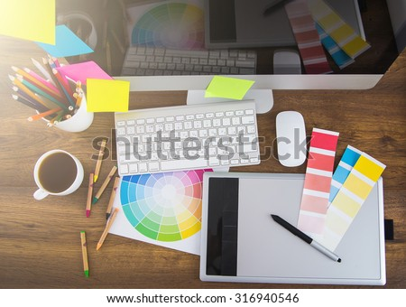 Modern office workplace with digital tablet, notepad, colorful pencils, glasses, in morning - stock photo
