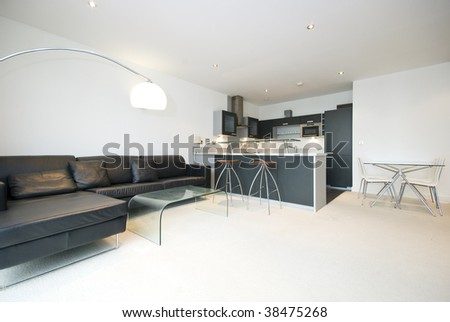 modern open plan living area with kitchen and high chairs - stock photo