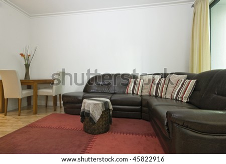 modern open plan living room with massive leather sofa - stock photo