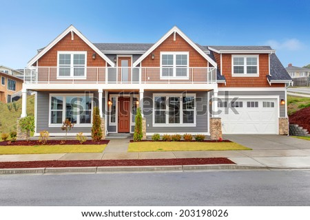 Modern orange and grey house with large screened walkout deck - stock photo