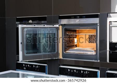 Modern oven with door open - stock photo