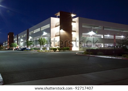 Modern Parking Garage at Night - stock photo