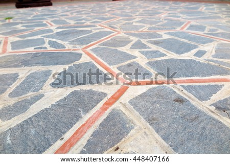 Modern paving tile made of cracked stones and laid out as hexagones