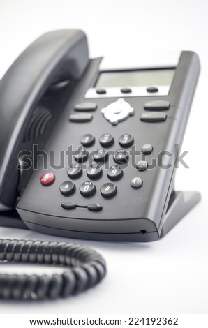 Modern Phone Close up of a modern, digital VOIP (voice over IP) phone with selective focus on the keypad. - stock photo