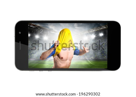 modern phone with soccer or football player on screen - stock photo