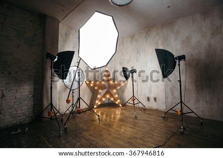 Modern photo studio interior with professional lighting equipment - stock photo