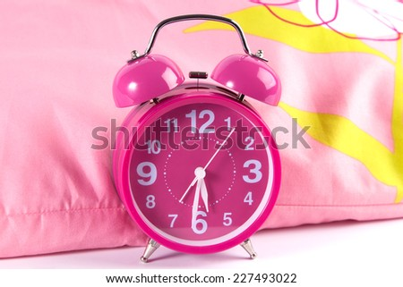 modern pink alarm clock on bed  and white background