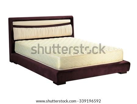 Modern platform bed with mattress - stock photo