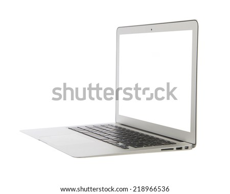 Modern popular business laptop computer with keyboard white screen isolated on a white background  - stock photo